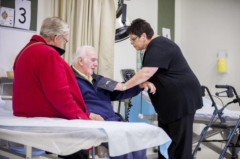 Community nurse taking blood pressure